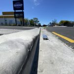 Custom installations of KERBY Aluminum driveway ramp can be done to overcome many strange curbs and gutter hollows. Here is a commercil property in Christchurch where Kerby would enable speedy safe exit from a busy street, without the massive bang/bump and taking out your wheel alignment. KERBY really is the best driveway access solution.