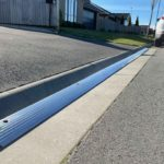 Straight section of an Aluminum Kerby driveway ramp for a typical driveway in a modern Selwyn subdivision