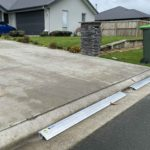 Here's x2 1.5m length sections of KERBY, an Aluminum driveway ramp as a budget option (yes we can cut driveway ramps to size/length provided that they use a full 3m length of driveway ramp) in a modern subdivision situated in Rolleston Selwyn. Installed by XDC.nz