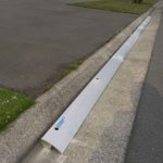 x3 3m lengths of KERBY in a double driveway – an Aluminum driveway ramp as an alternative to rubber or tread-plate – to slightly overhang the edges where the 'lazy turning' of the car goes in a modern subdivision situated in Rolleston Selwyn. Installed by XDC.nz
