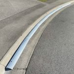 Struggling to find a driveway ramp that can go around corners - x6 1m length sections of KERBY, an Aluminum driveway ramp extrusion for a very concave driveway in a cul-de-sac is perfect for the job and looks great