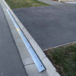 x2 3m lengths of KERBY, an Aluminum driveway ramp to overhang the edges where the 'lazy turning' of the car goes in a modern subdivision situated in Rolleston Selwyn. Installed by XDC.nz
