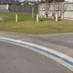 x6 1m length sections of an Aluminum Kerby driveway ramp for a very curved driveway entrance concave driveway in a cul-de-sac in a Rolleston subdivision. Looks great and lasts forever! Far superior to rubber ramps or folded tread plate that rusts.
